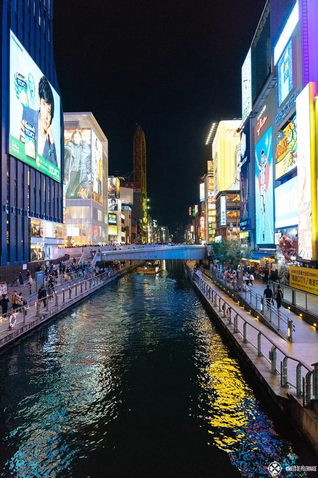 The bridges over the channel in the dotombori district in Osaka at night