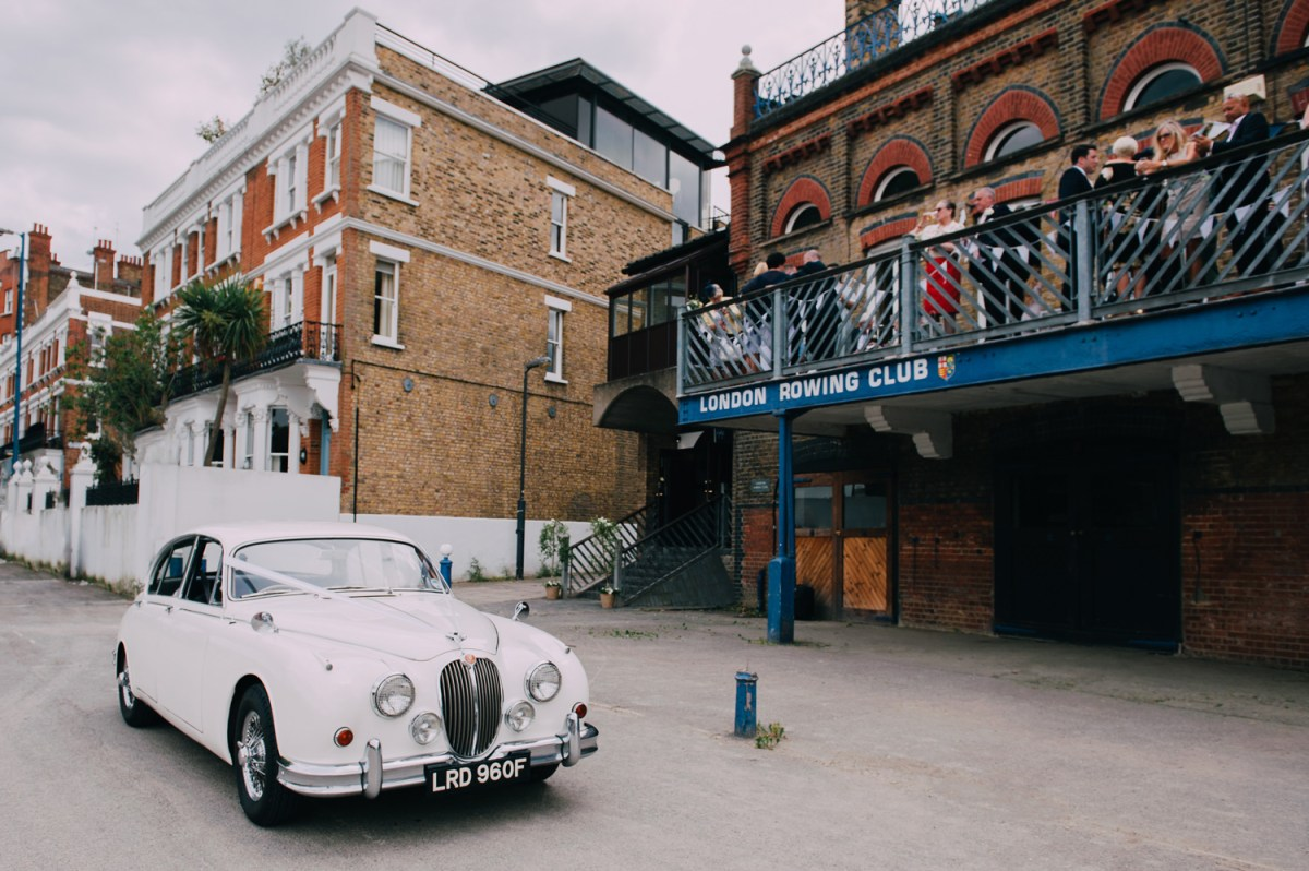 vintage white wedding car in front of london rowing club