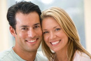 Couple indoors smiling
