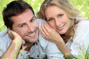 bigstock-Happy-couple-lying-on-grass-31172741