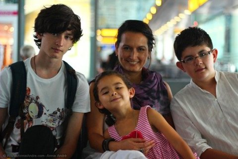 Getting Permission to travel or live abroad long term with kids: Me with my three kids at some random airport waiting for our next flight (2012).