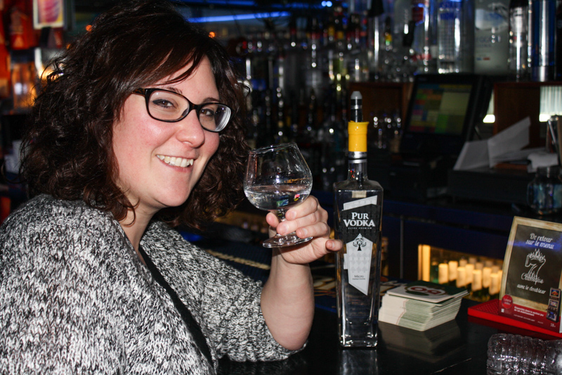 Annie drinking to celebrate