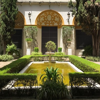 One of Seville's many tranquil courtyards, fountains and plants