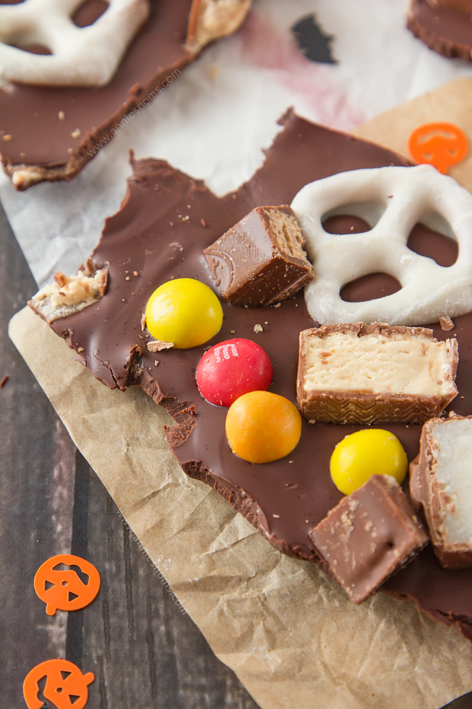 This Halloween Candy Bark is the perfect way to use up leftover Halloween candy. Crunchy, sweet and a little bit salty. This is an easy, kid-friendly recipe that everyone will love!