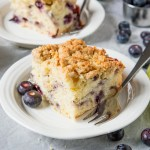 A soft and juicy Blueberry and Lime cake topped with the most amazing crunchy crumb topping. The perfect zesty and tender cake to enjoy with a cup of coffee!