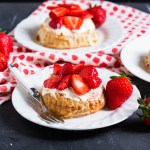 These ridiculously easy Strawberry and Clotted Cream Tarts are ready in under an hour and marry together, flaky puff pastry, sweet strawberries and thick clotted cream; the perfect summer dessert!