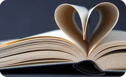 Book with pages folded into a loveheart shape to represent research for the history