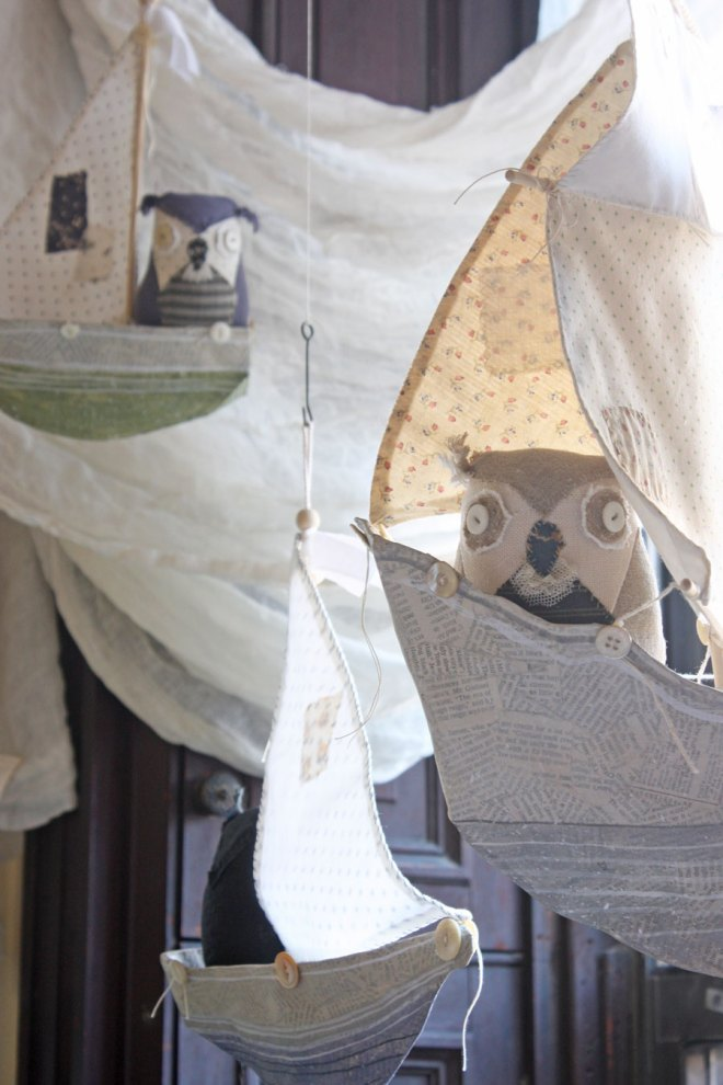 paper mache ships with owl captains