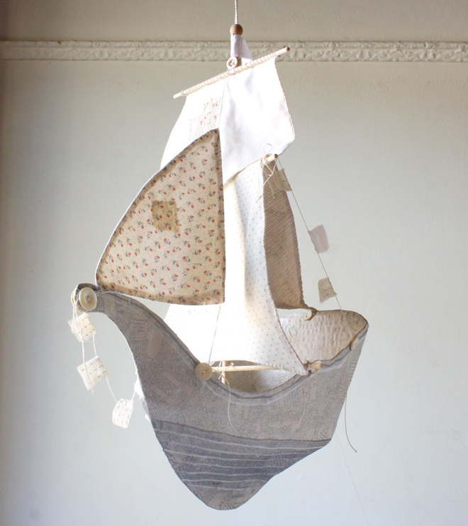 ivory and gray paper mache ship