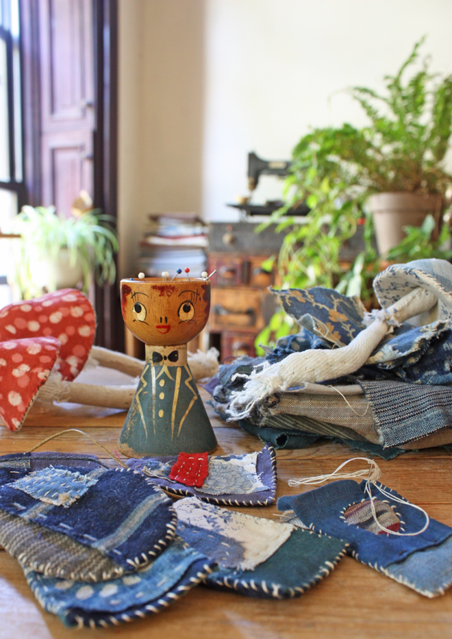 fabric amulets and mushrooms on my work table