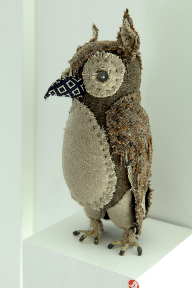 owl made from earth colored wool scraps with button eyes