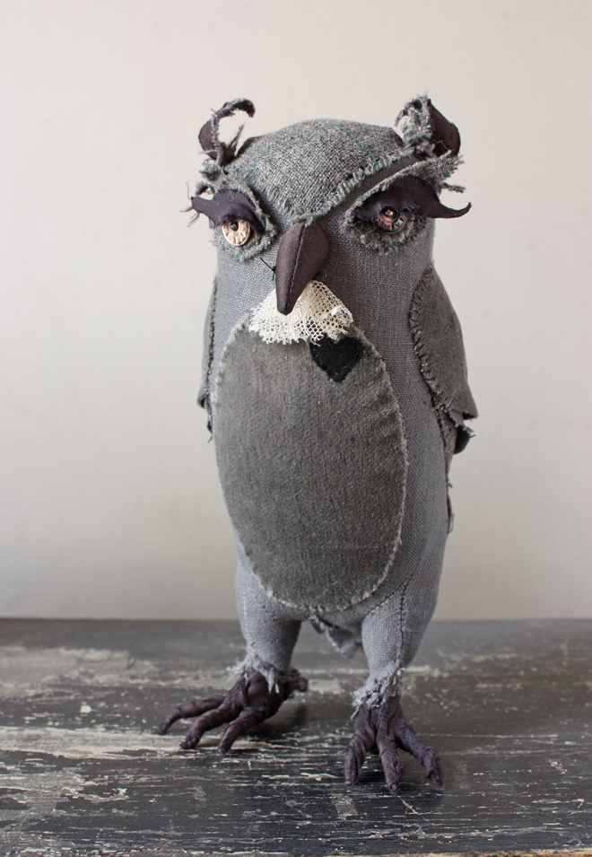 a gray soft sculpture owl