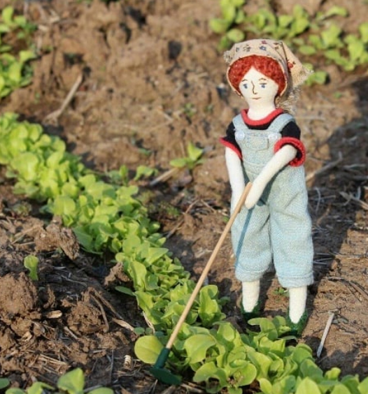 tiny rag doll gardening
