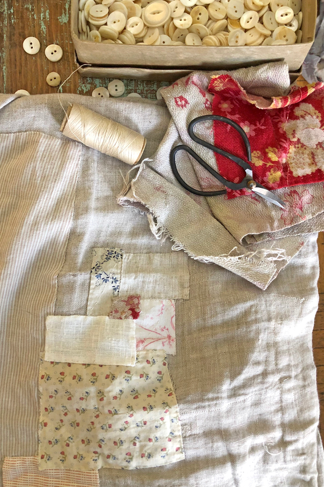mending a linen smock with scraps