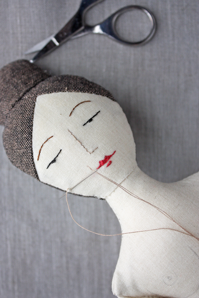 embroidering a doll face