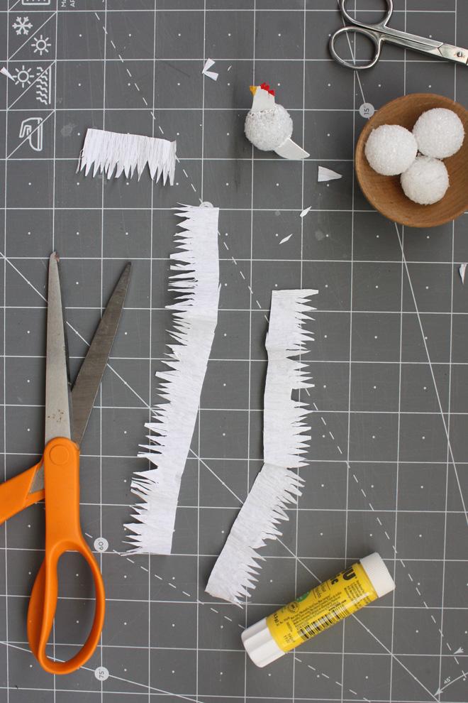 cut paper hen feathers