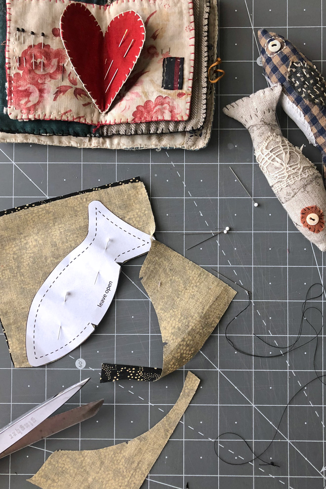 cutting out fabric fish shape