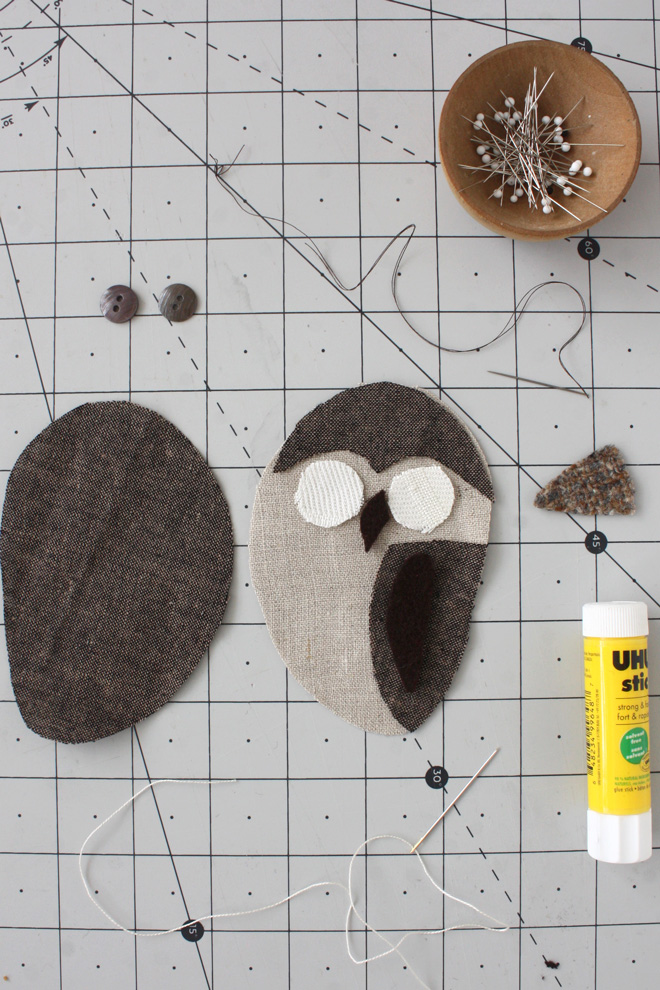 assembling the owl layers with glue stick