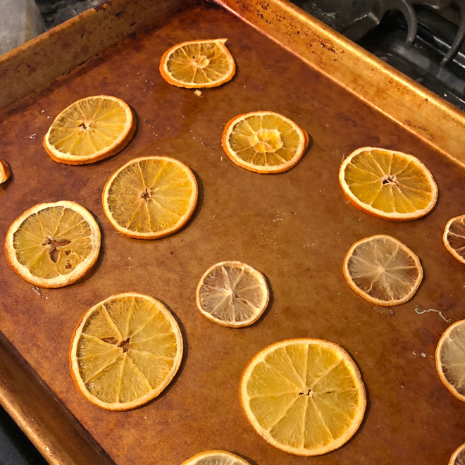 baking orange slices on a cookie sheet