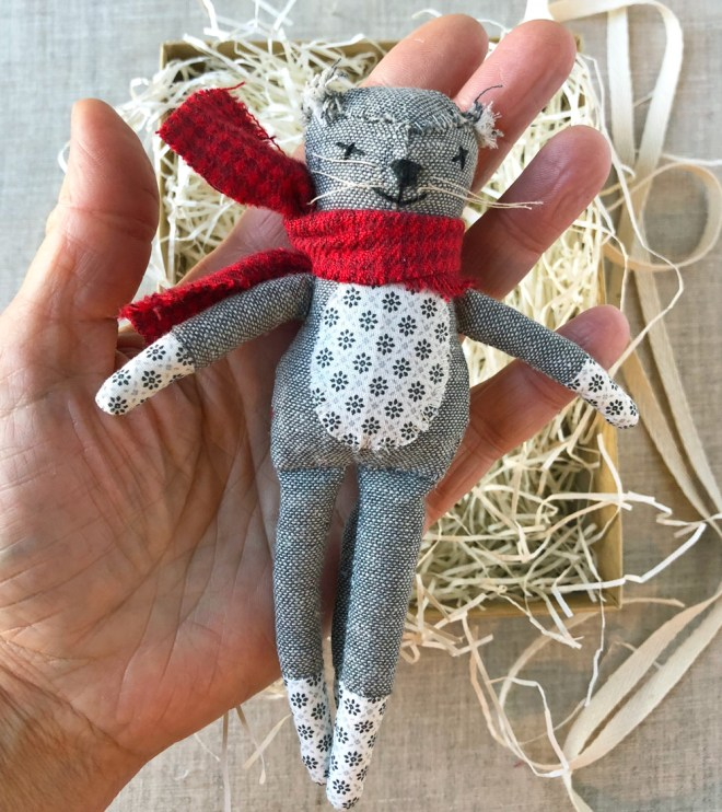 small cat rag doll in hand