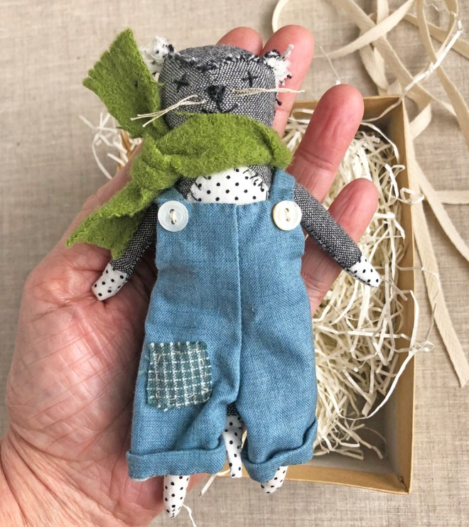 tiny cat doll with overalls