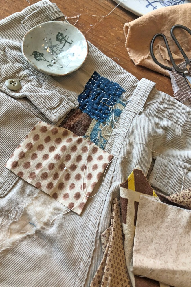 patching over a tear in corduroy shorts