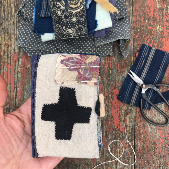 small cloth book with patches