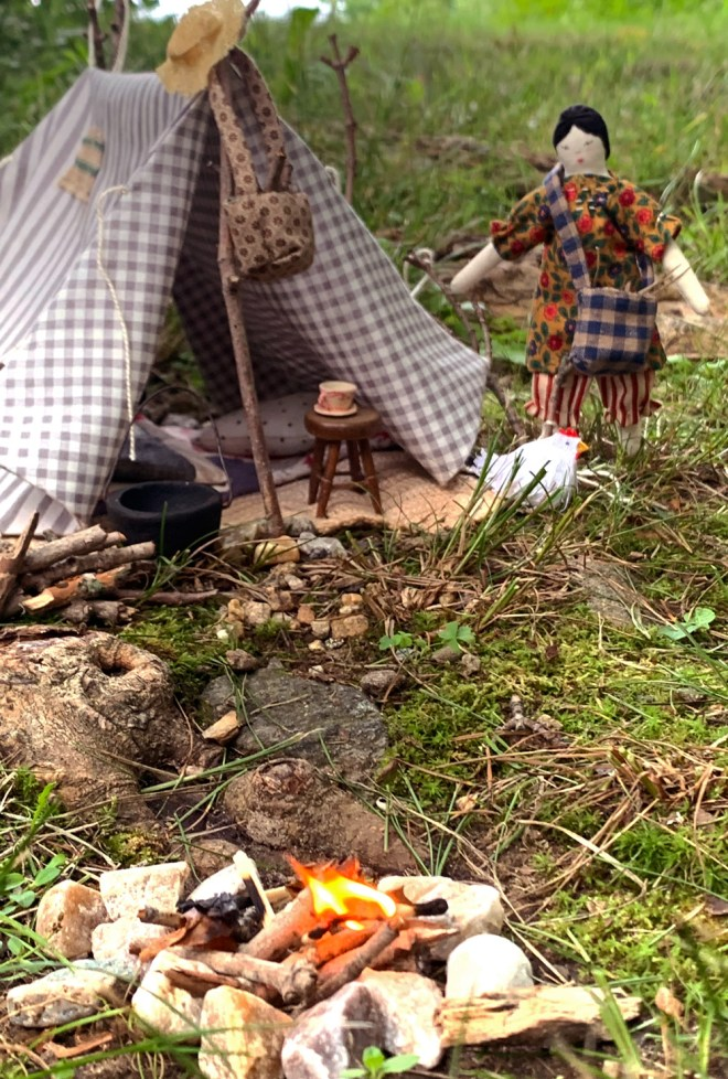 miniature tent, campsite and doll in forest