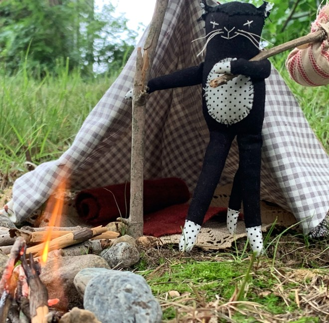 cat doll with mini tent and campfire