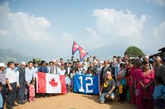 Sharada and ABIN team with Seahawks flag