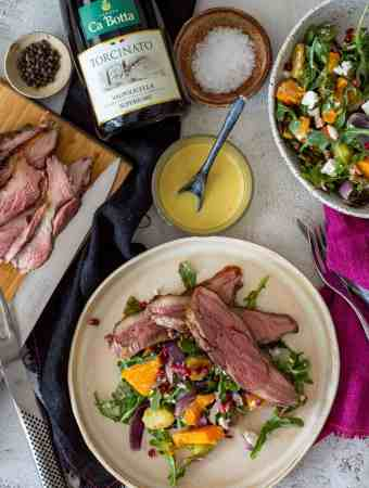grilled lamb & veg salad, bottle of red wine and cooked sliced lamb