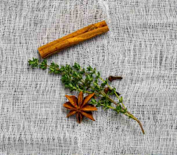 anise, clove, thyme & cinnamon on muslin cloth