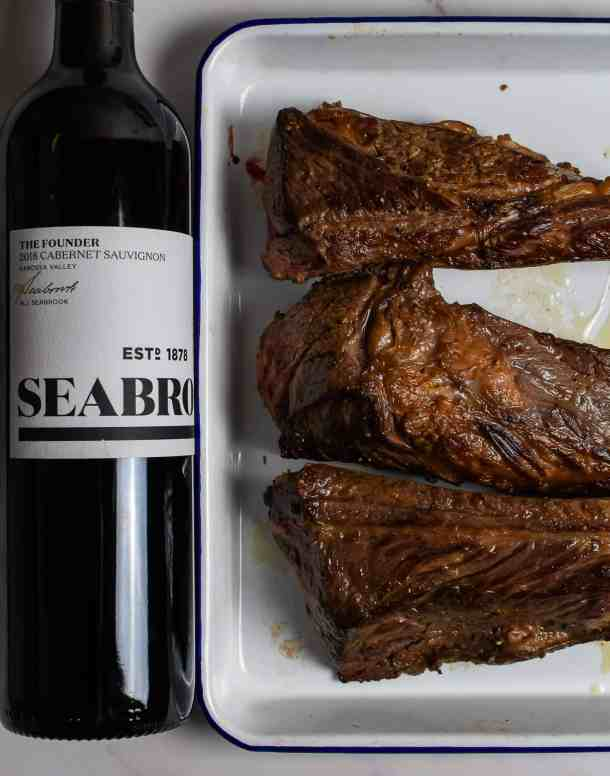 seared short ribs & bottle of seabrook cabernet sauvignon