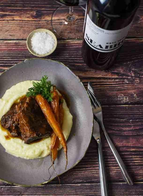 seabrook cabernet sauvignon, cutlery & bowl of mushroom braised short ribs