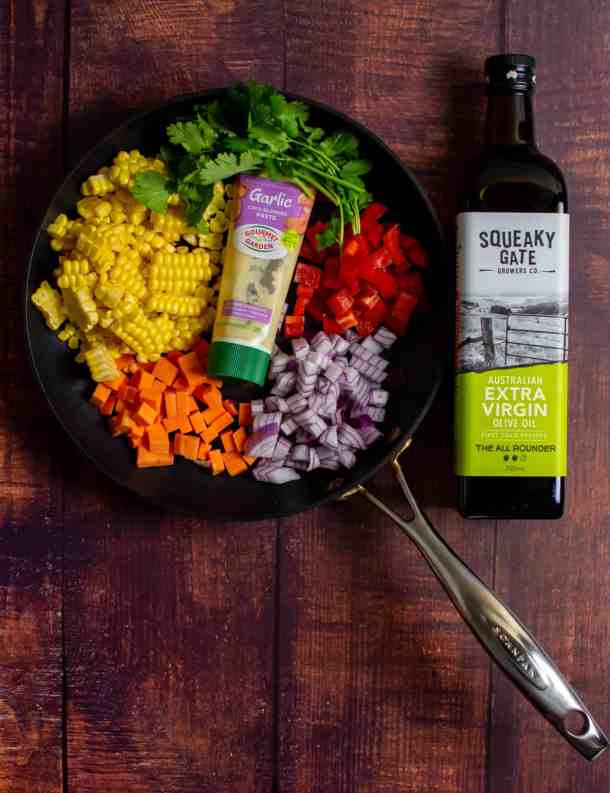 squeaky gate olive oil, scanpan pan & vegetables on a table