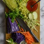 slaw ingredients, global chef knife on chopping board