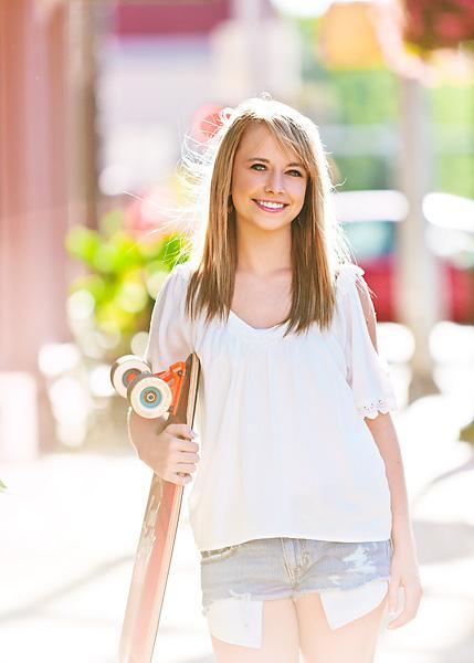 high school senior on sidewalk
