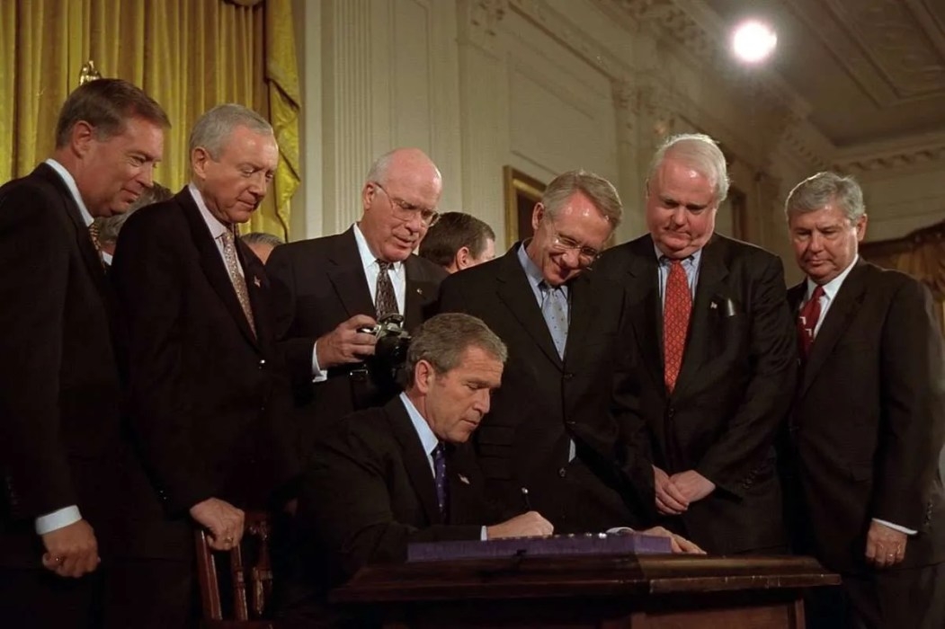 President George W. Bush signs the Patriot Act, October 26, 2001 | Public Domain