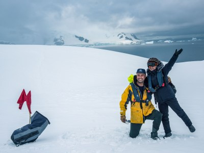 Pablo Zenteno, from our Expedition team, with a happy traveler in Antarctica
