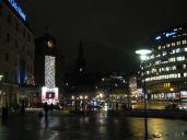 Nighttime in Oslo, near a downtown shopping center.
