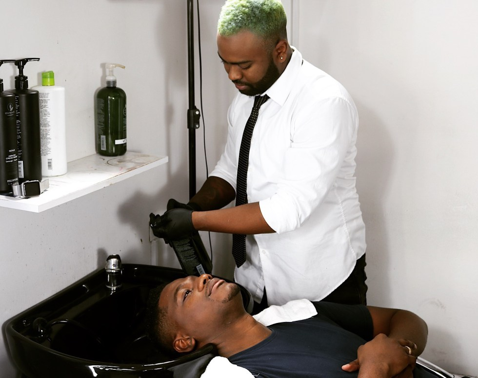 Sheldon Cornwall of Gala Banana Studios applies Paul Mitchell Tea Tree Shampoo to one of his regular customers.