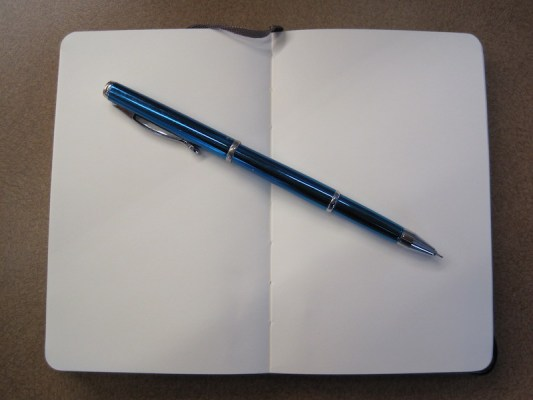 Notebook and blue pen