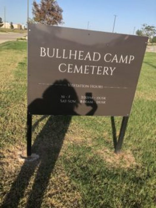 Photograph of a large sign for Bullhead Camp Cemetery