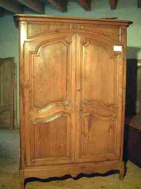 armoire l xv en merisier ancienne a motifs scultes