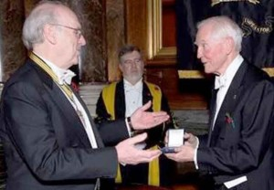 Dr John C Taylor receives the Harrison Medal.