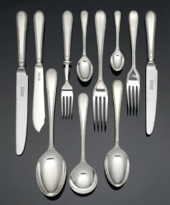 A collection of silver bead pattern flatware and cutlery, Garrard & Co