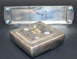 A Liberty & Co Cymric silver and turquoise inlaid inkwell, hallmarked London 1902