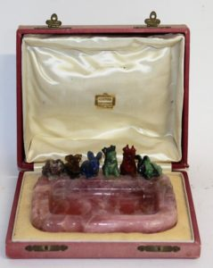 Cartier carved rose quartz ashtray with six carved chalcedony and quartz dogs