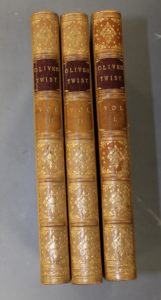 Very early edition three volume Oliver Twist, inc 'Fireside Plate' Lot 216