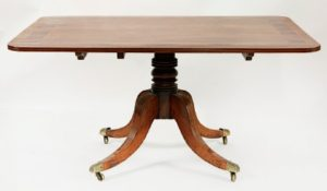 A mahogany centre pedestal breakfast table